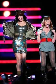 Singer Katy Perry and comedian Kathy Griffin perform onstage. Photo: Getty Images