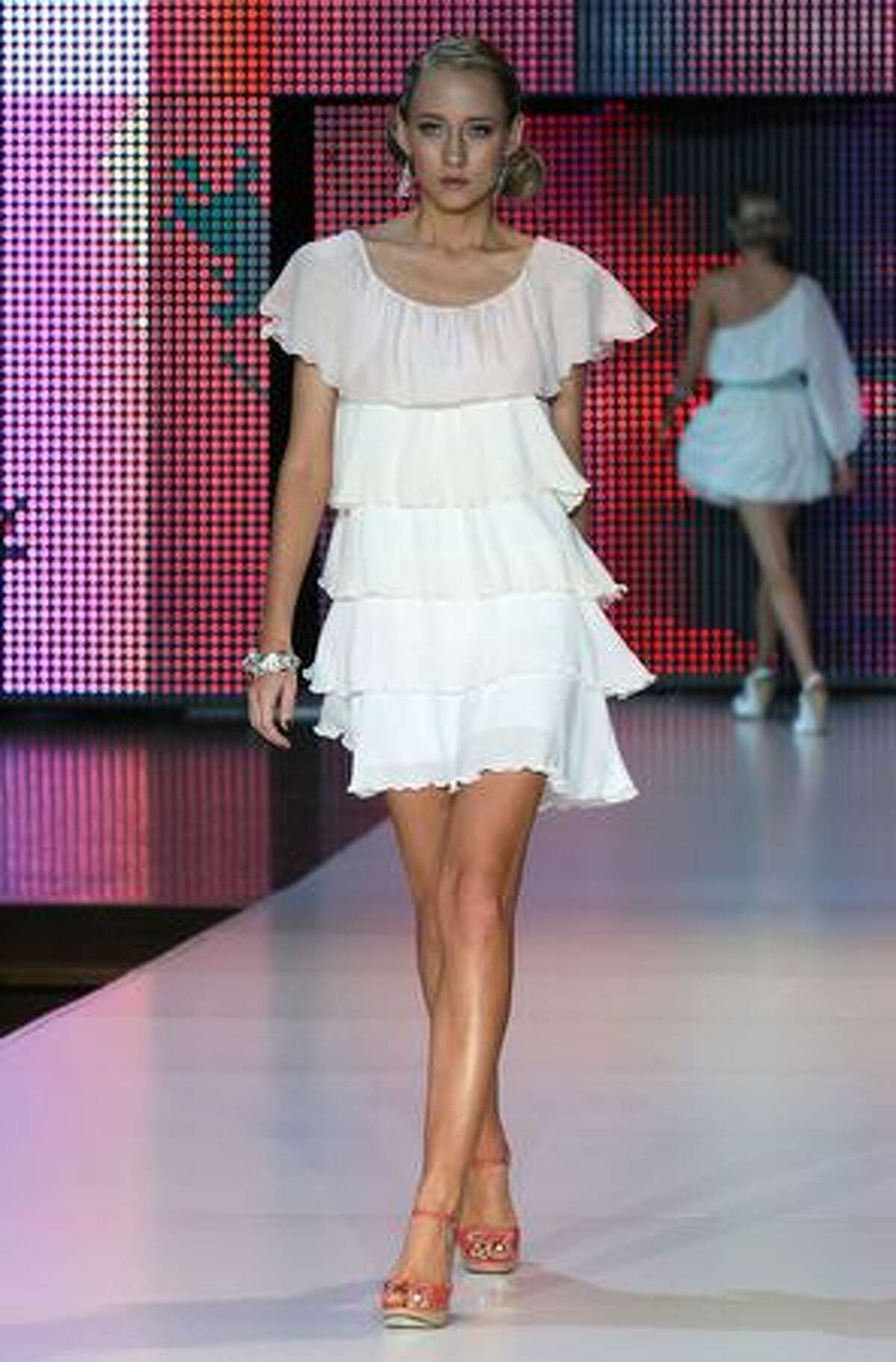 A model showcases a design by Frockshop.
