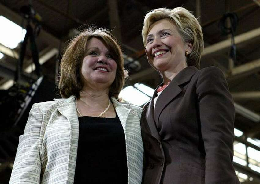 Elizabeth Edwards (L) stands with former First Lady Senator Hillary Rodham Clinton (D-NY) during a Kerry/Edwards Victory 2004 breakfast reception July 9, 2004 in New York City.
