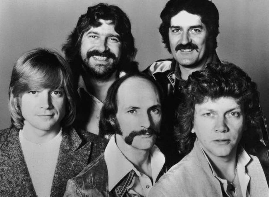 British rock group The Moody Blues, 26th July 1978. From left to right, (top) Graeme Edge and Ray Thomas, (bottom) John Lodge, Mike Pinder and Justin Hayward. Photo: Getty Images