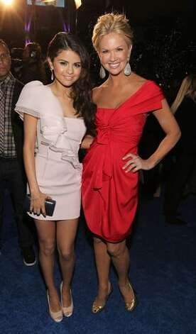 Actress/singer Selena Gomez and TV host Nancy O'Dell arrive at the 2011 People's Choice Awards at Nokia Theatre L.A. Live in Los Angeles, California. Photo: Getty Images
