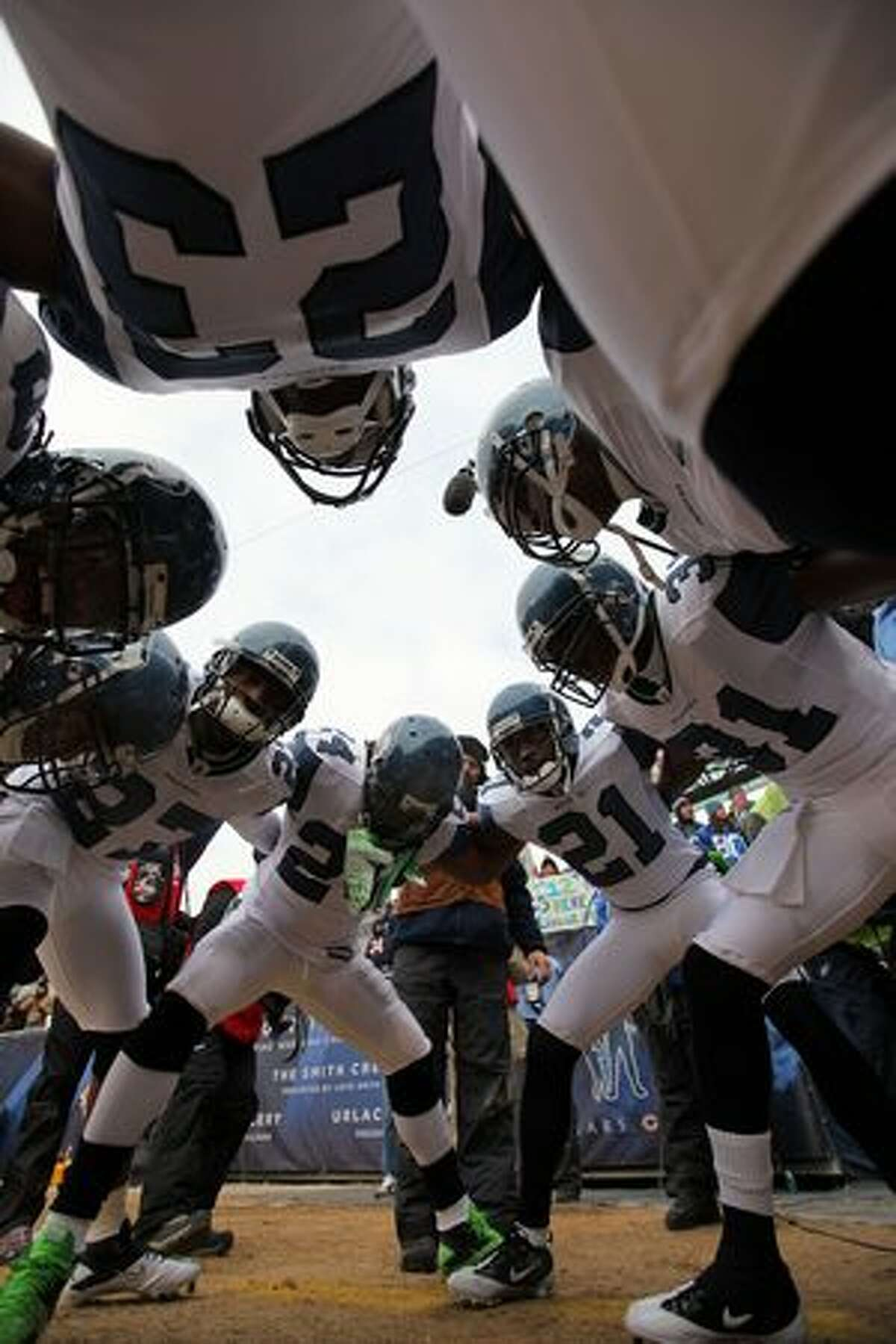 CHICAGO, IL - JANUARY 16: The Seattle Seahawks huddle before taking on the Chicago Bears in the 2011 NFC divisional playoff game at Soldier Field on January 16, 2011 in Chicago, Illinois.