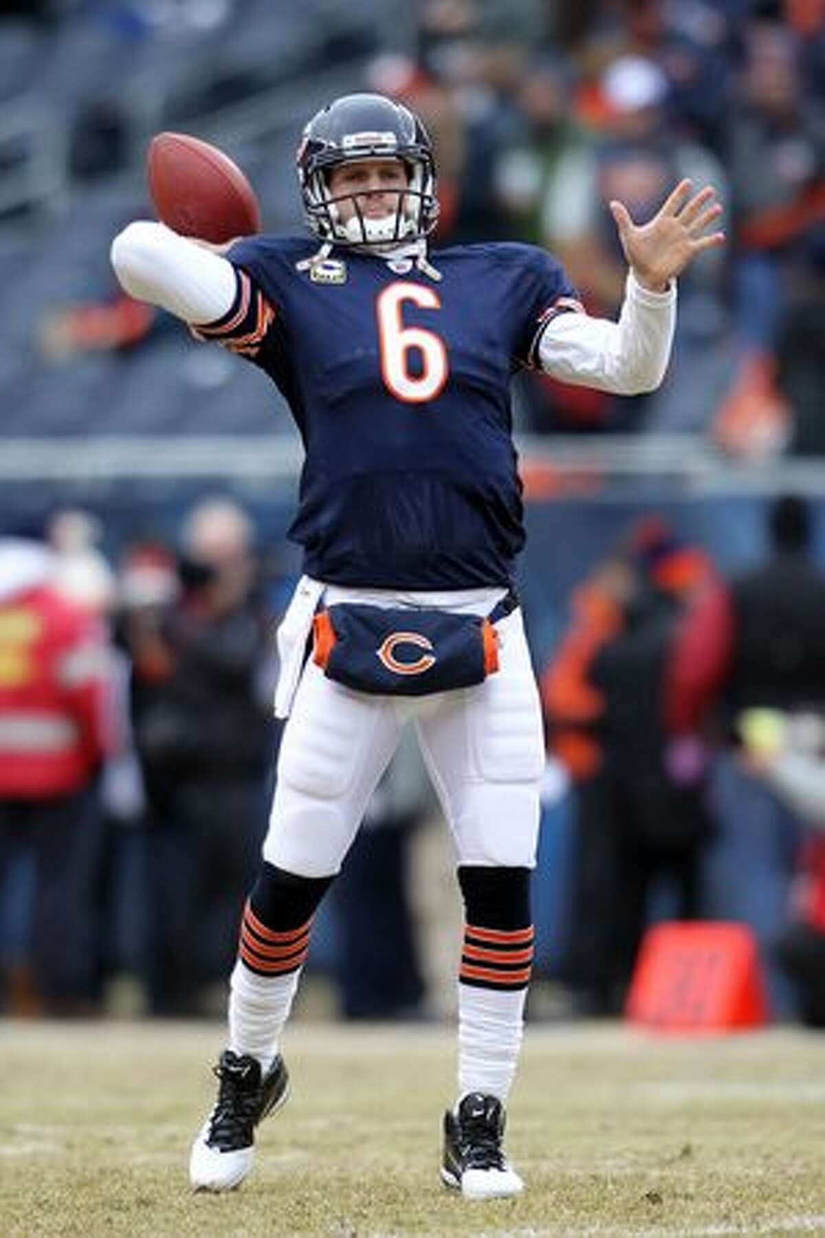 CHICAGO, IL - JANUARY 16: Quarterback Jay Cutler #6 of the Chicago Bears throws the ball during pregame before the Bears take on the Seattle Seahawks in the 2011 NFC divisional playoff game at Soldier Field on January 16, 2011 in Chicago, Illinois.