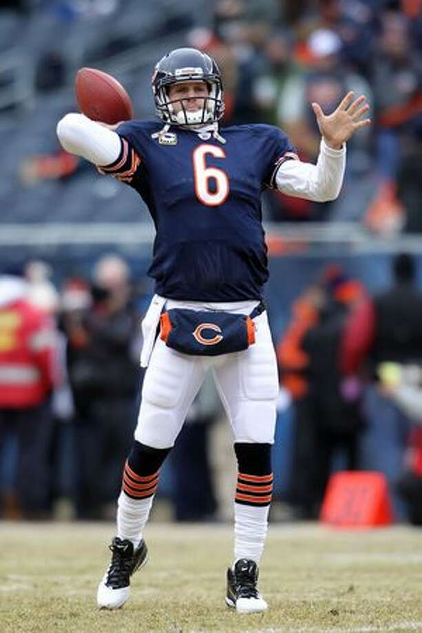 CHICAGO, IL - JANUARY 16: Quarterback Jay Cutler #6 of the Chicago Bears throws the ball during pregame before the Bears take on the Seattle Seahawks in the 2011 NFC divisional playoff game at Soldier Field on January 16, 2011 in Chicago, Illinois. Photo: Getty Images