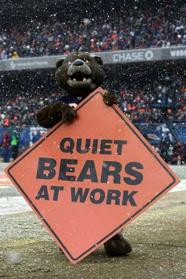 CHICAGO, IL - JANUARY 16: The Chicago Bears holds a sign on the field in the first half against the Seattle Seahawks in the 2011 NFC divisional playoff game at Soldier Field on January 16, 2011 in Chicago, Illinois. Photo: Getty Images
