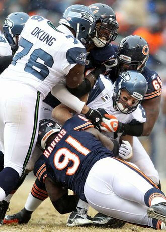 CHICAGO, IL - JANUARY 16: Quarterback Matt Hasselbeck #8 of the Seattle Seahawks is sacked by three members of the Chicago Bears defense in the first half during the 2011 NFC divisional playoff game at Soldier Field on January 16, 2011 in Chicago, Illinois. Photo: Getty Images