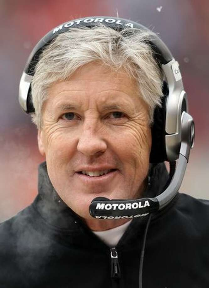 CHICAGO, IL - JANUARY 16: Head coach Pete Carroll of the Seattle Seahawks looks on from the sideline in the first half against the Chicago Bears in the 2011 NFC divisional playoff game at Soldier Field on January 16, 2011 in Chicago, Illinois. Photo: Getty Images