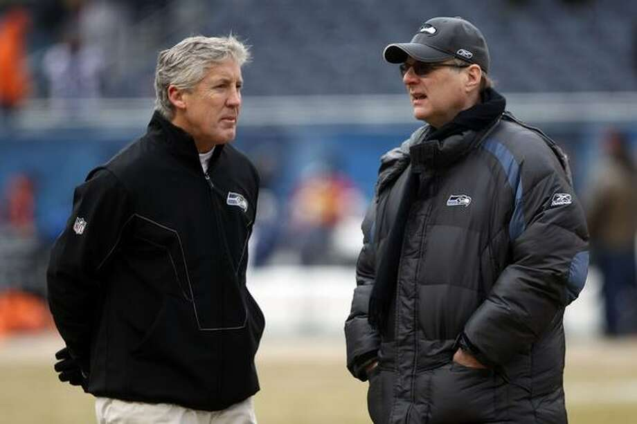 CHICAGO, IL - JANUARY 16: (L-R) Head coach Pete Carroll of the Seattle Seahawks talks with Seahawks team owner Paul Allen before the 2011 NFC divisional playoff game against the Chicago Bears at Soldier Field on January 16, 2011 in Chicago, Illinois. Photo: Getty Images