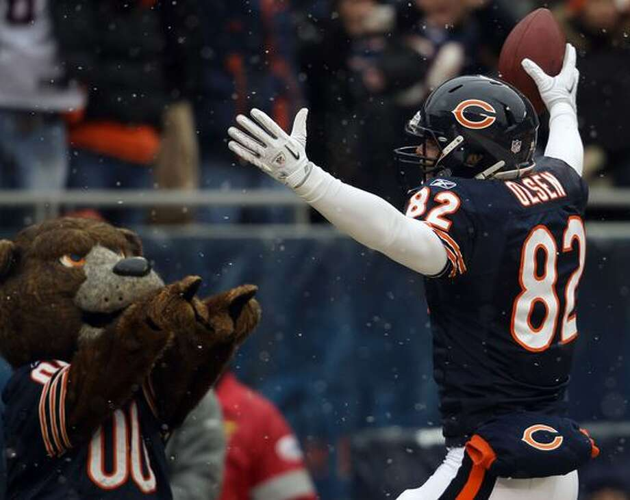 CHICAGO, IL - JANUARY 16: Tight end Greg Olsen #82 of the Chicago Bears reacts after he scores on a 58-yard touchdown reception in the first quarter against the Seattle Seahawks in the 2011 NFC divisional playoff game at Soldier Field on January 16, 2011 in Chicago, Illinois. Photo: Getty Images