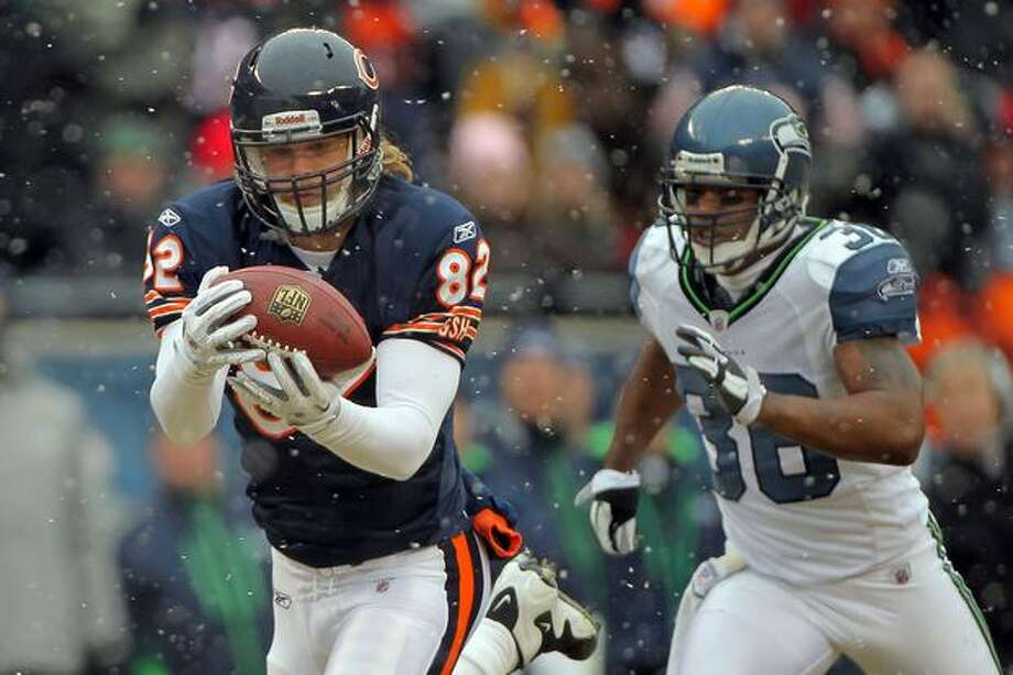 CHICAGO, IL - JANUARY 16: Tight end Greg Olsen #82 of the Chicago Bears catches a 58-yard touchdown in the first quarter in front of Lawyer Milloy #36 of the Seattle Seahawks in the 2011 NFC divisional playoff game at Soldier Field on January 16, 2011 in Chicago, Illinois. Photo: Getty Images
