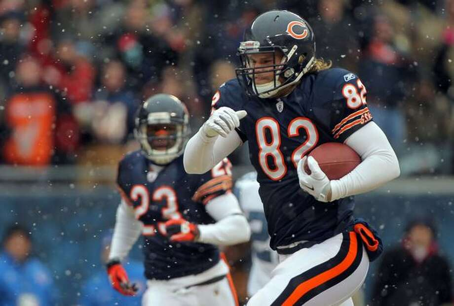 CHICAGO, IL - JANUARY 16: Tight end Greg Olsen #82 of the Chicago Bears runs after he catches a 58-yard touchdown in the first quarter in front of Lawyer Milloy #36 of the Seattle Seahawks in the 2011 NFC divisional playoff game at Soldier Field on January 16, 2011 in Chicago, Illinois. Photo: Getty Images