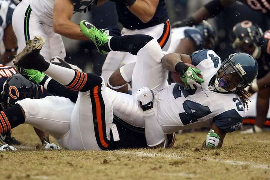 CHICAGO, IL - JANUARY 16: Running back Marshawn Lynch #24 of the Seattle Seahawks is tackled by Israel Idonije #71 of the Chicago Bears after a run in the first quarter during the 2011 NFC divisional playoff game at Soldier Field on January 16, 2011 in Chicago, Illinois. Photo: Getty Images