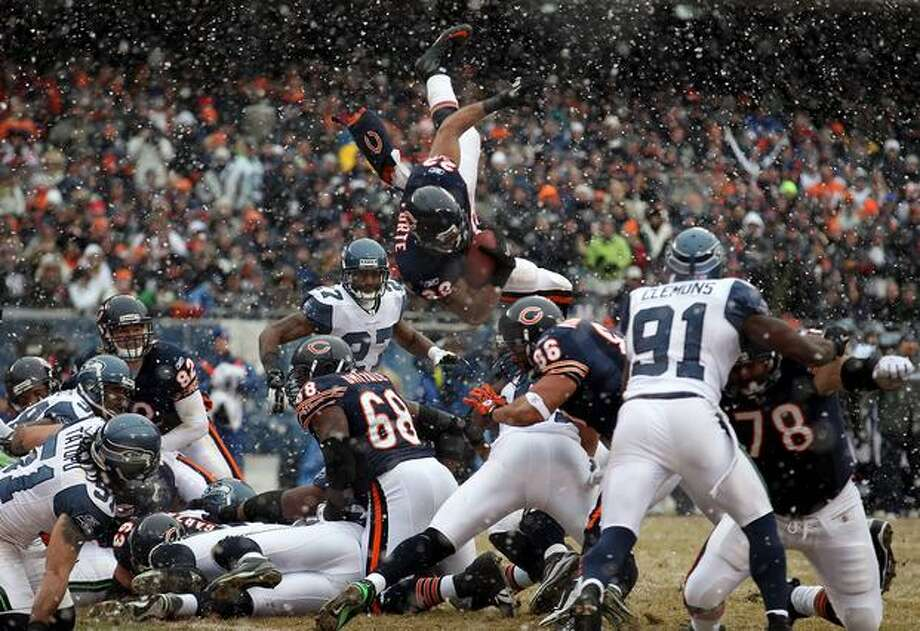 CHICAGO, IL - JANUARY 16: Running back Matt Forte #22 of the Chicago Bears attempts to jump into the endzone but is stopped short in the second quarter against the Seattle Seahawks in the 2011 NFC divisional playoff game at Soldier Field on January 16, 2011 in Chicago, Illinois. Photo: Getty Images