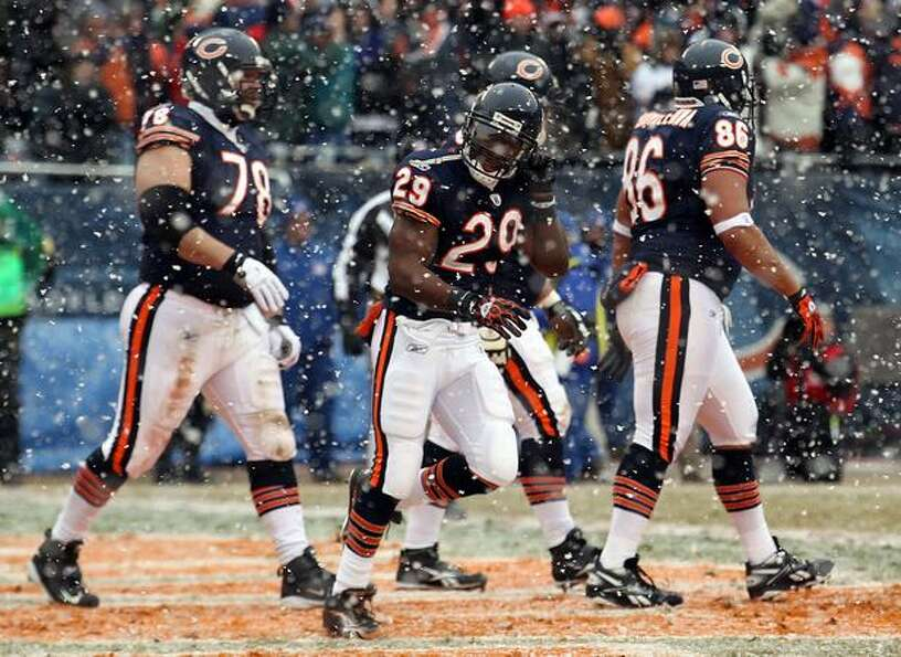 CHICAGO, IL - JANUARY 16: Running back Chester Taylor #29 of the Chicago Bears reacts after scoring