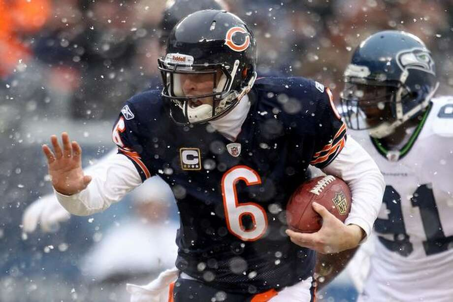 CHICAGO, IL - JANUARY 16: Quarterback Jay Cutler #6 of the Chicago Bears runs the ball to score on a six-yard touchdown against the Seattle Seahawks in the second quarter of the 2011 NFC divisional playoff game at Soldier Field on January 16, 2011 in Chicago, Illinois. Photo: Getty Images