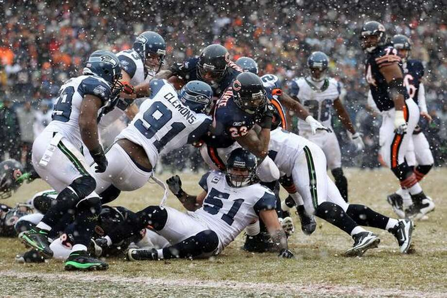 CHICAGO, IL - JANUARY 16: Running back Matt Forte #22 of the Chicago Bears attempts to score but is stopped short in the second quarter against the Seattle Seahawks in the 2011 NFC divisional playoff game at Soldier Field on January 16, 2011 in Chicago, Illinois. Photo: Getty Images