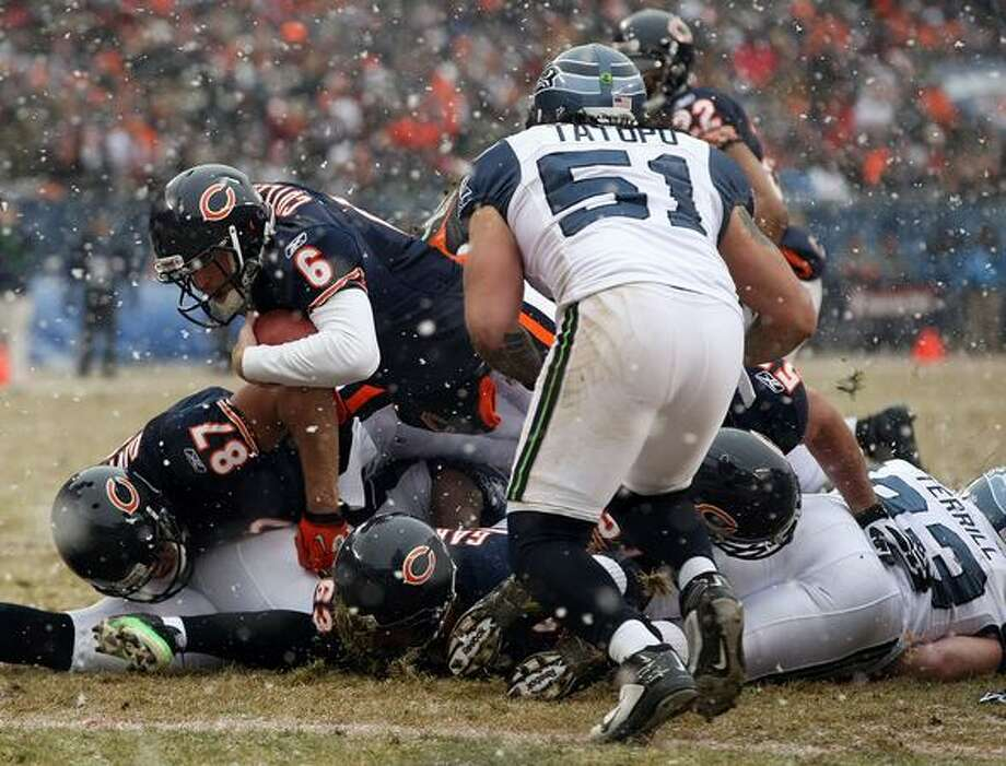 CHICAGO, IL - JANUARY 16: Quarterback Jay Cutler #6 of the Chicago Bears attempts to score but is stopped short in the second quarter against the Seattle Seahawks in the 2011 NFC divisional playoff game at Soldier Field on January 16, 2011 in Chicago, Illinois. Photo: Getty Images