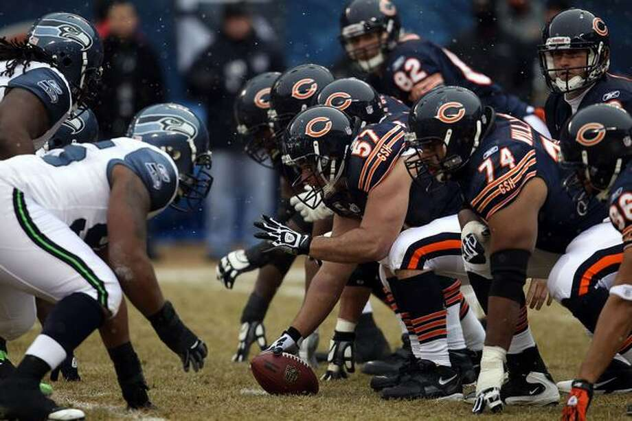 CHICAGO, IL - JANUARY 16: Center Olin Kreutz #57 of the Chicago Bears prepares to snap the ball against the Seattle Seahawks in the first half in the 2011 NFC divisional playoff game at Soldier Field on January 16, 2011 in Chicago, Illinois. Photo: Getty Images