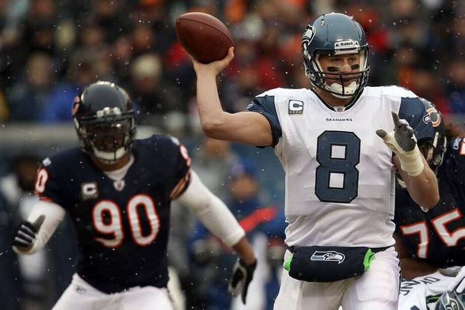 CHICAGO, IL - JANUARY 16: Quarterback Matt Hasselbeck #8 of the Seattle Seahawks throws the ball as Julius Peppers #90 of the Chicago Bears attempts to run in for the sack in the first half in the 2011 NFC divisional playoff game at Soldier Field on January 16, 2011 in Chicago, Illinois. Photo: Getty Images