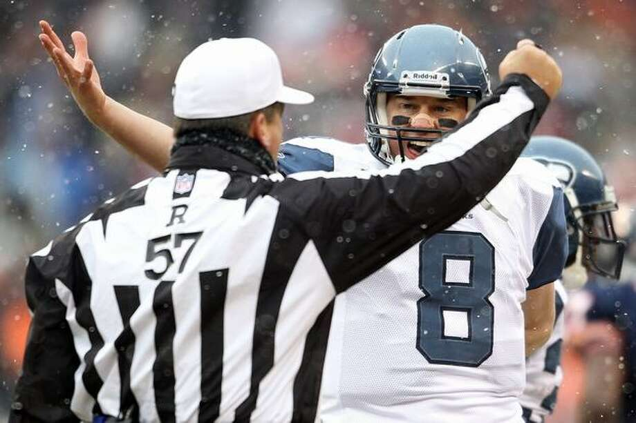 CHICAGO, IL - JANUARY 16: Quarterback Matt Hasselbeck #8 of the Seattle Seahawks argues with referee Al Riveron #57 in the first half against the Chicago Bears in the 2011 NFC divisional playoff game at Soldier Field on January 16, 2011 in Chicago, Illinois. Photo: Getty Images
