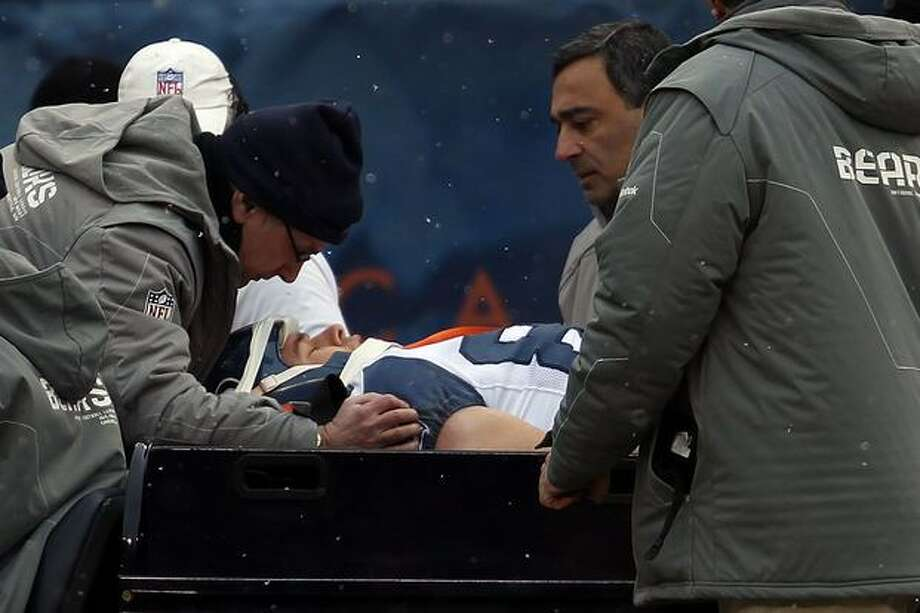 CHICAGO, IL - JANUARY 16: Tight end John Carlson #89 of the Seattle Seahawks is carted off the field after an apparent head injury in the first quarter against the Chicago Bears in the 2011 NFC divisional playoff game at Soldier Field on January 16, 2011 in Chicago, Illinois. Photo: Getty Images
