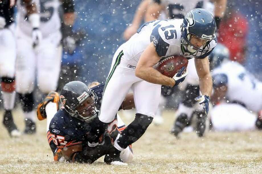 CHICAGO, IL - JANUARY 16: Brandon Stokley #15 of the Seattle Seahawks attempts to run after a catch as Lance Briggs #55 of the Chicago Bears attempts to tackle him in the first half in the 2011 NFC divisional playoff game at Soldier Field on January 16, 2011 in Chicago, Illinois. Photo: Getty Images