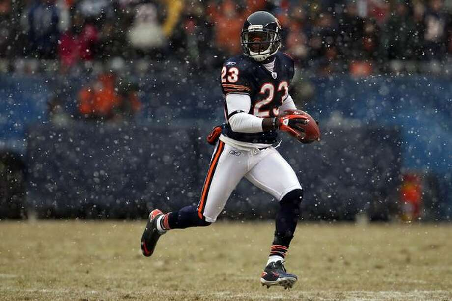 CHICAGO, IL - JANUARY 16: Kick returner Devin Hester #23 of the Chicago Bears returns a punt in the first half against the Seattle Seahawks in the 2011 NFC divisional playoff game at Soldier Field on January 16, 2011 in Chicago, Illinois. Photo: Getty Images