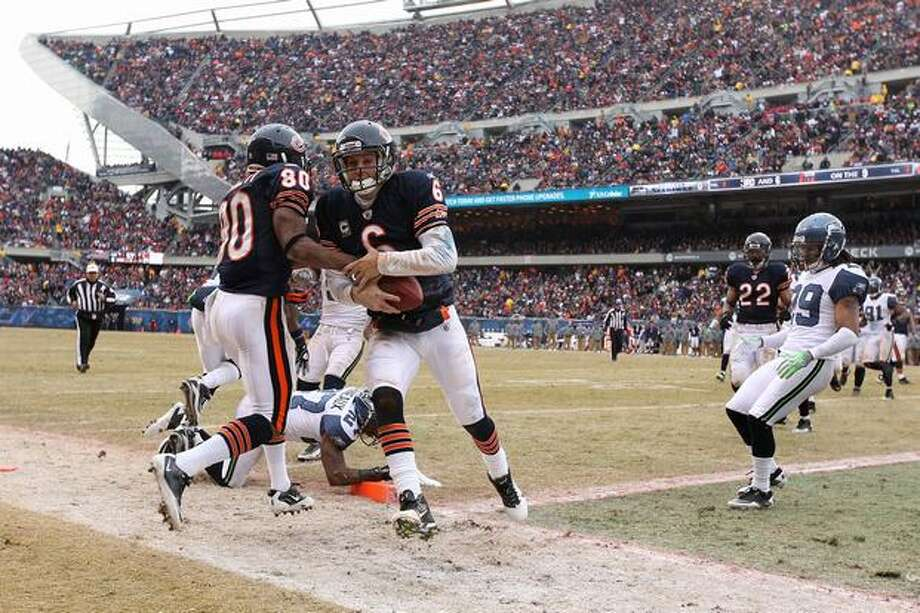 CHICAGO, IL - JANUARY 16: Quarterback Jay Cutler #6 of the Chicago Bears scores on a nine-yard touchdown run in the third quarter against the Seattle Seahawks in the 2011 NFC divisional playoff game at Soldier Field on January 16, 2011 in Chicago, Illinois. Photo: Getty Images