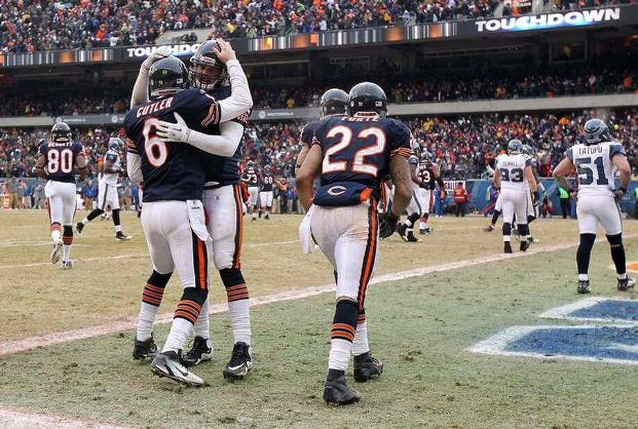 CHICAGO, IL - JANUARY 16: Quarterback Jay Cutler #6 of the Chicago Bears celebrates with teammate Greg Olsen #82 after Cutler scores on a nine-yard touchdown run in the third quarter against the Seattle Seahawks in the 2011 NFC divisional playoff game at Soldier Field on January 16, 2011 in Chicago, Illinois. Photo: Getty Images