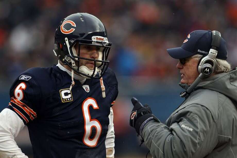 CHICAGO, IL - JANUARY 16: Quarterback Jay Cutler #6 of the Chicago Bears talks with offensive coordinator Mike Martz in the second half against the Seattle Seahawks in the 2011 NFC divisional playoff game at Soldier Field on January 16, 2011 in Chicago, Illinois. Photo: Getty Images