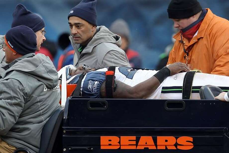 CHICAGO, IL - JANUARY 16: Marcus Trufant #23 of the Seattle Seahawks is carted off the field after an injury against the Chicago Bears in the 2011 NFC divisional playoff game at Soldier Field on January 16, 2011 in Chicago, Illinois. Photo: Getty Images