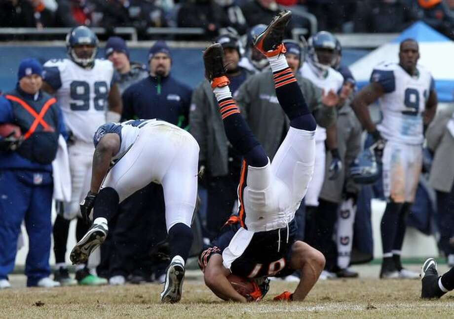 CHICAGO, IL - JANUARY 16: Kellen Davis #87 of the Chicago Bears flips over after making a catch against David Hawthorne #57 of the Seattle Seahawks in the third quarter of the 2011 NFC divisional playoff game at Soldier Field on January 16, 2011 in Chicago, Illinois. Photo: Getty Images