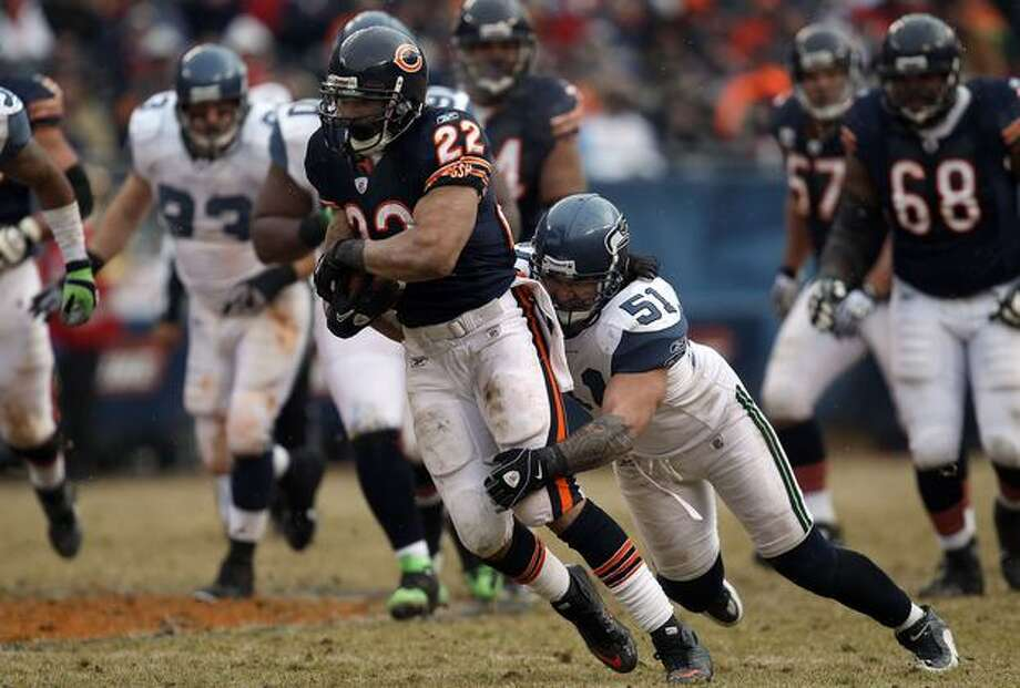 CHICAGO, IL - JANUARY 16: Running back Matt Forte #22 of the Chicago Bears runs the ball as Lofa Tatupu #51 of the Seattle Seahawks attempts to tackle him from behind in the 2011 NFC divisional playoff game at Soldier Field on January 16, 2011 in Chicago, Illinois. Photo: Getty Images