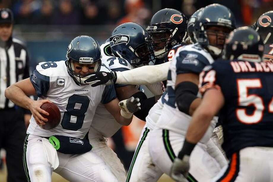 CHICAGO, IL - JANUARY 16: Quarterback Matt Hasselbeck #8 of the Seattle Seahawks attempts to avoid a sack by Julius Peppers #90 of the Chicago Bears in the second half in the 2011 NFC divisional playoff game at Soldier Field on January 16, 2011 in Chicago, Illinois. Photo: Getty Images