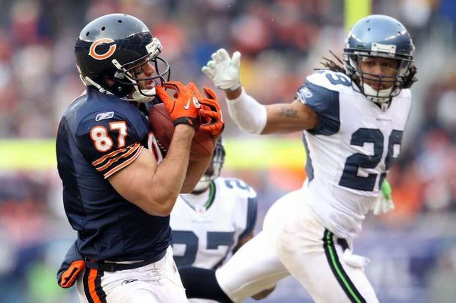 CHICAGO, IL - JANUARY 16: Tight end Kellen Davis #87 of the Chicago Bears catches a 39-yard touchdown in the fourth quarter against the Seattle Seahawks in the 2011 NFC divisional playoff game at Soldier Field on January 16, 2011 in Chicago, Illinois. Photo: Getty Images