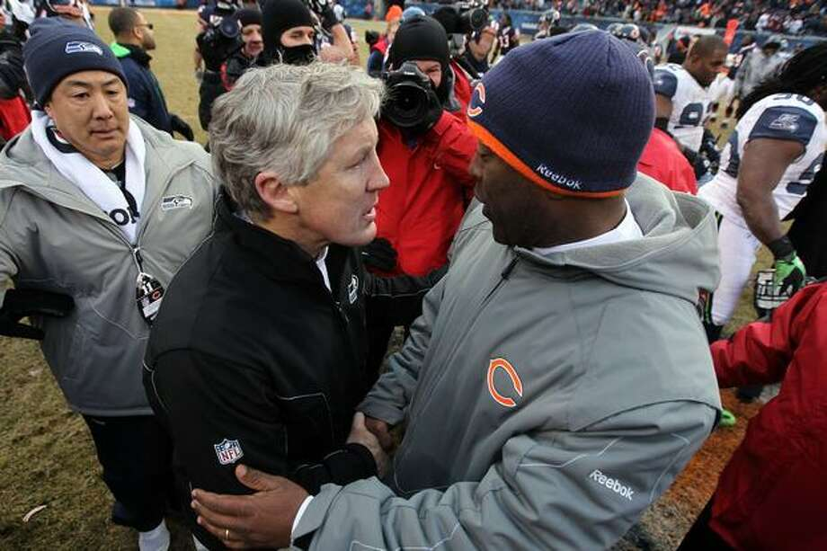 CHICAGO, IL - JANUARY 16: Head coach Pete Carroll of the Seattle Seahawks and head coach Lovie Smith of the Chicago Bears shake hands after the Bears 35-24 victory in the 2011 NFC divisional playoff game at Soldier Field on January 16, 2011 in Chicago, Illinois. Photo: Getty Images