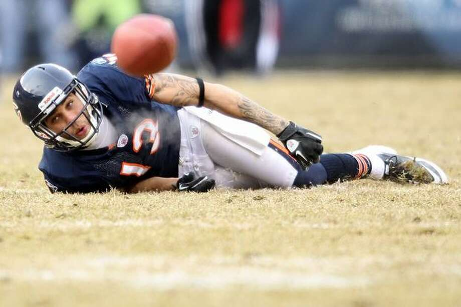 CHICAGO, IL - JANUARY 16: Wide receiver Johnny Knox #13 of the Chicago Bears looks at the ball late in the game against the Seattle Seahawks in the 2011 NFC divisional playoff game at Soldier Field on January 16, 2011 in Chicago, Illinois. Photo: Getty Images