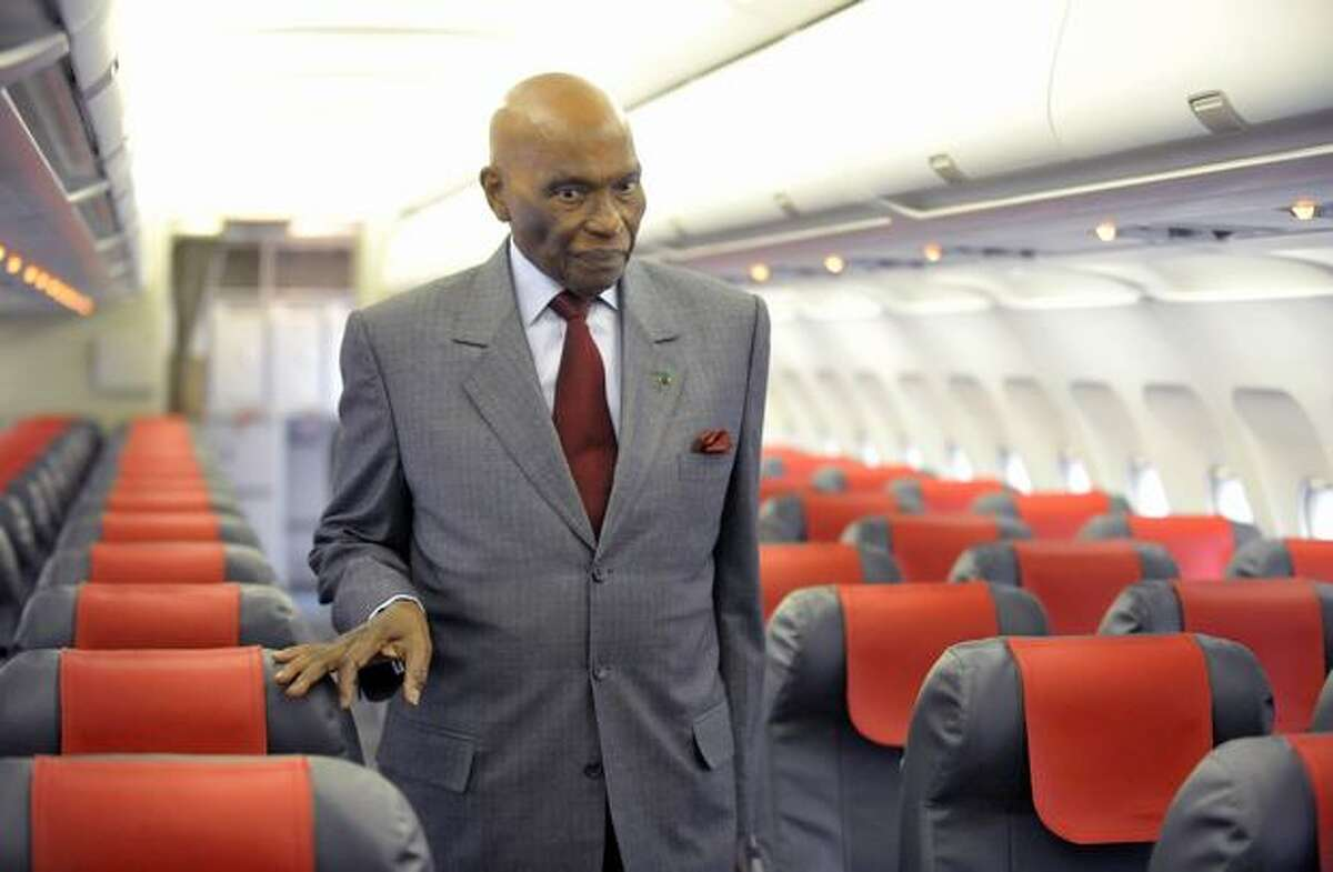 Senegalese President Abdoulaye Wade inspects a Senegal Airlines Airbus A320 in Dakar. The airline plans to launch its first flight on January 25, 2011.