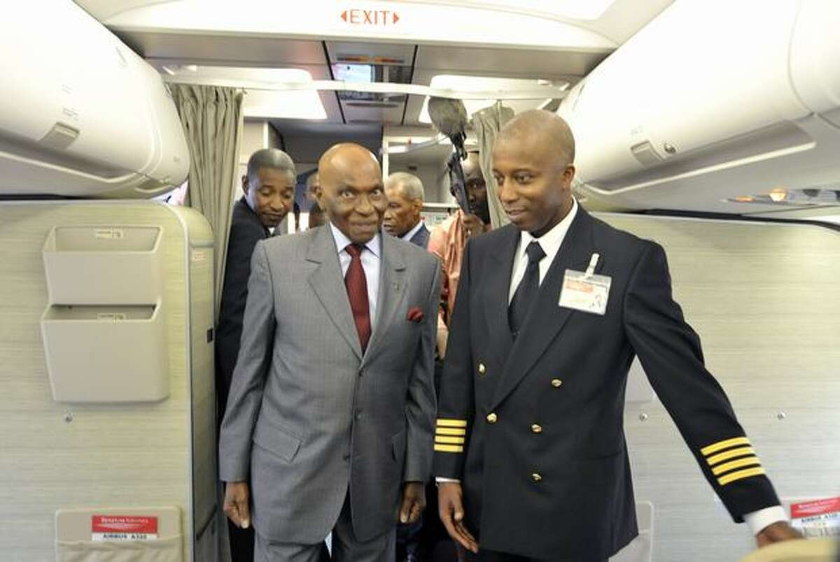 Senegalese President Abdoulaye Wade inspects a Senegal Airlines Airbus A320 with pilot Jean Louis Ngome in Dakar. The airline plans to launch its first flight on January 25, 2011.