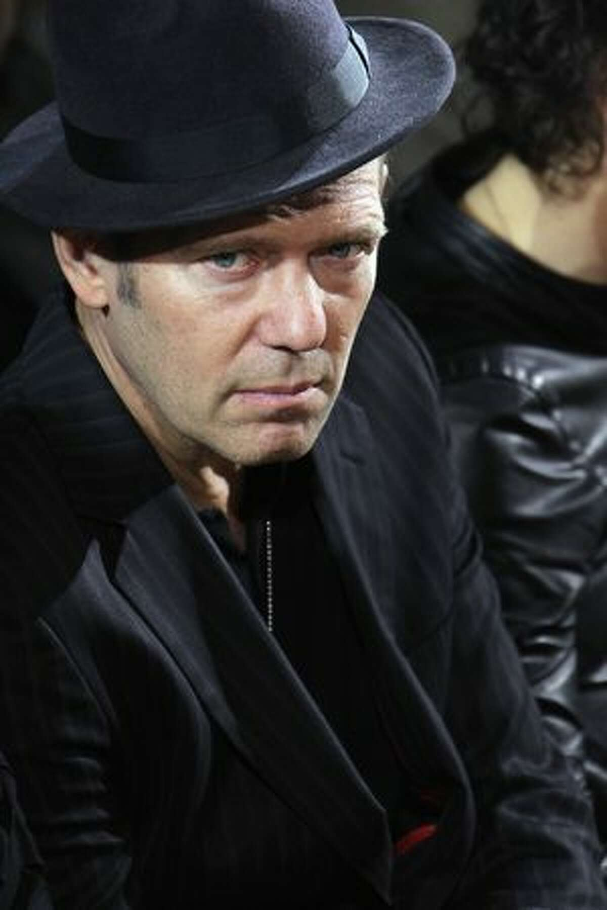 'The Clash' bassist Paul Simonon attends the Yves Saint Laurent fashion show as part of Paris Menswear Fashion Week Fall/Winter 2011-2012 at Artemis in Paris, France.