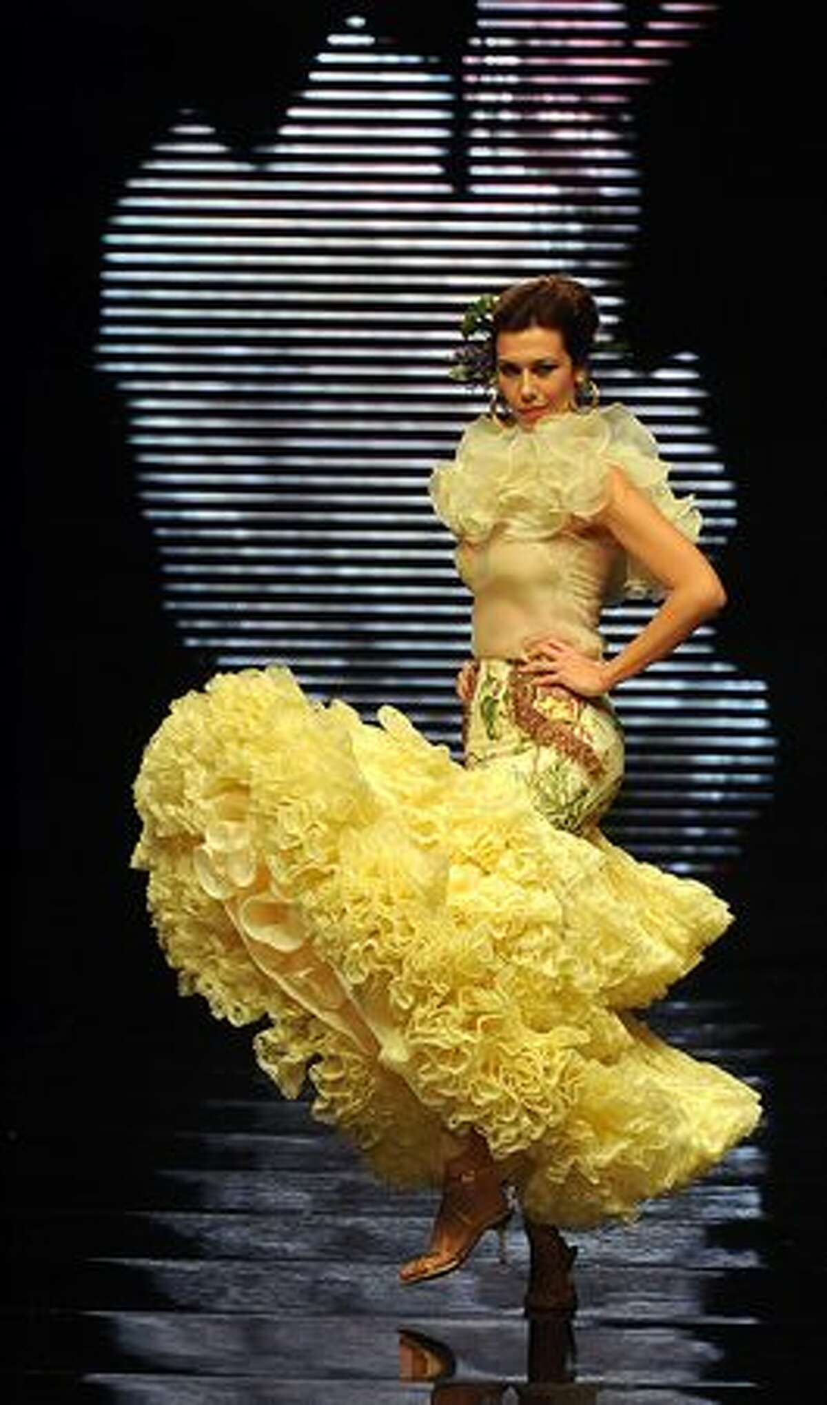 A model presents a creation by Spanish designer Curro Duran during the SIMOF 2011 (International Flamenco Fashion Exhibition) in Sevilla.