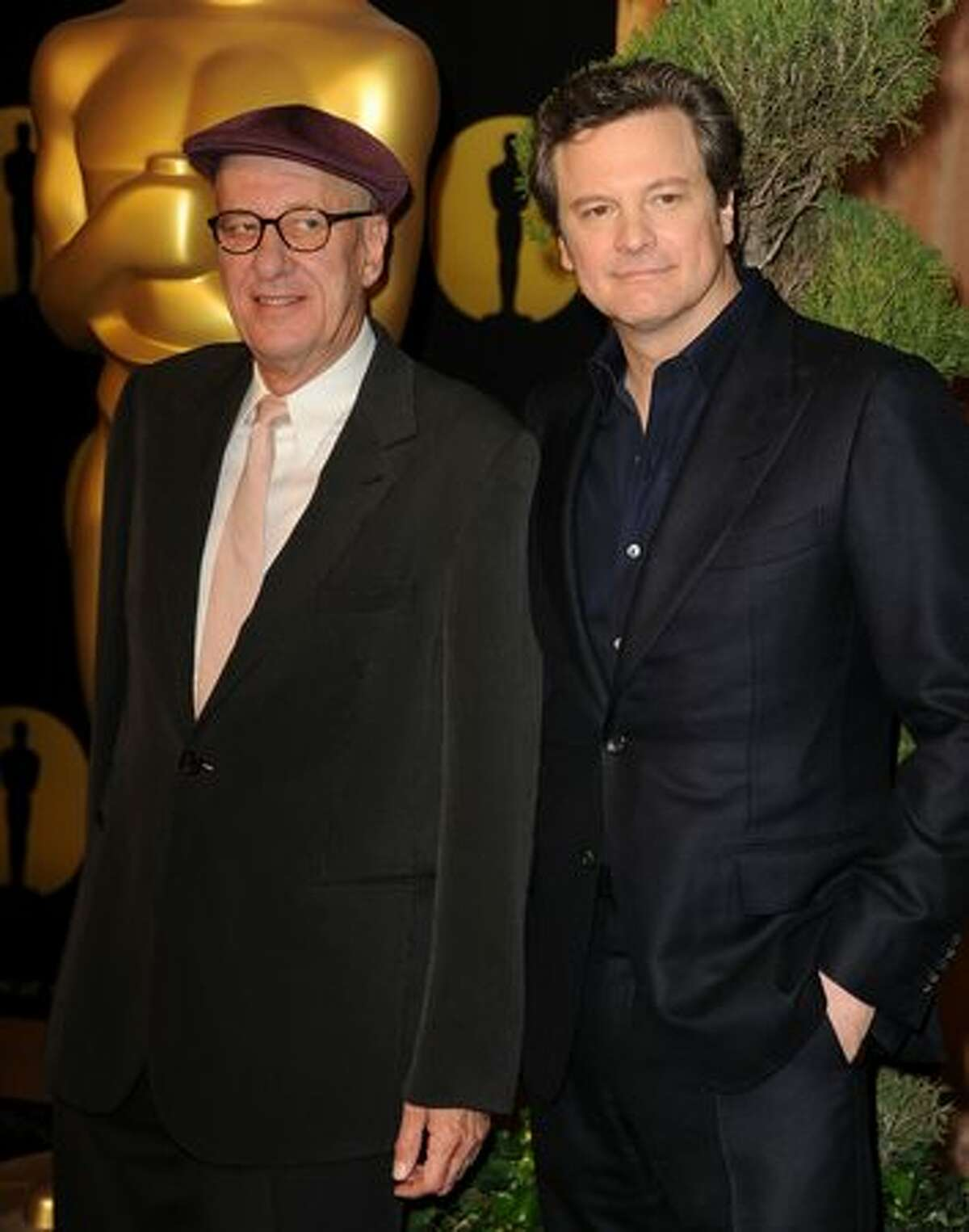 Actors Geoffrey Rush (L) and Colin Firth arrive at the 83rd Academy Awards nominations luncheon held at the Beverly Hilton Hotel in Beverly Hills, California.