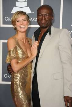 Model Heidi Klum and singer Seal arrive at The 53rd Annual GRAMMY Awards held at Staples Center in Los Angeles, California. Photo: Getty Images