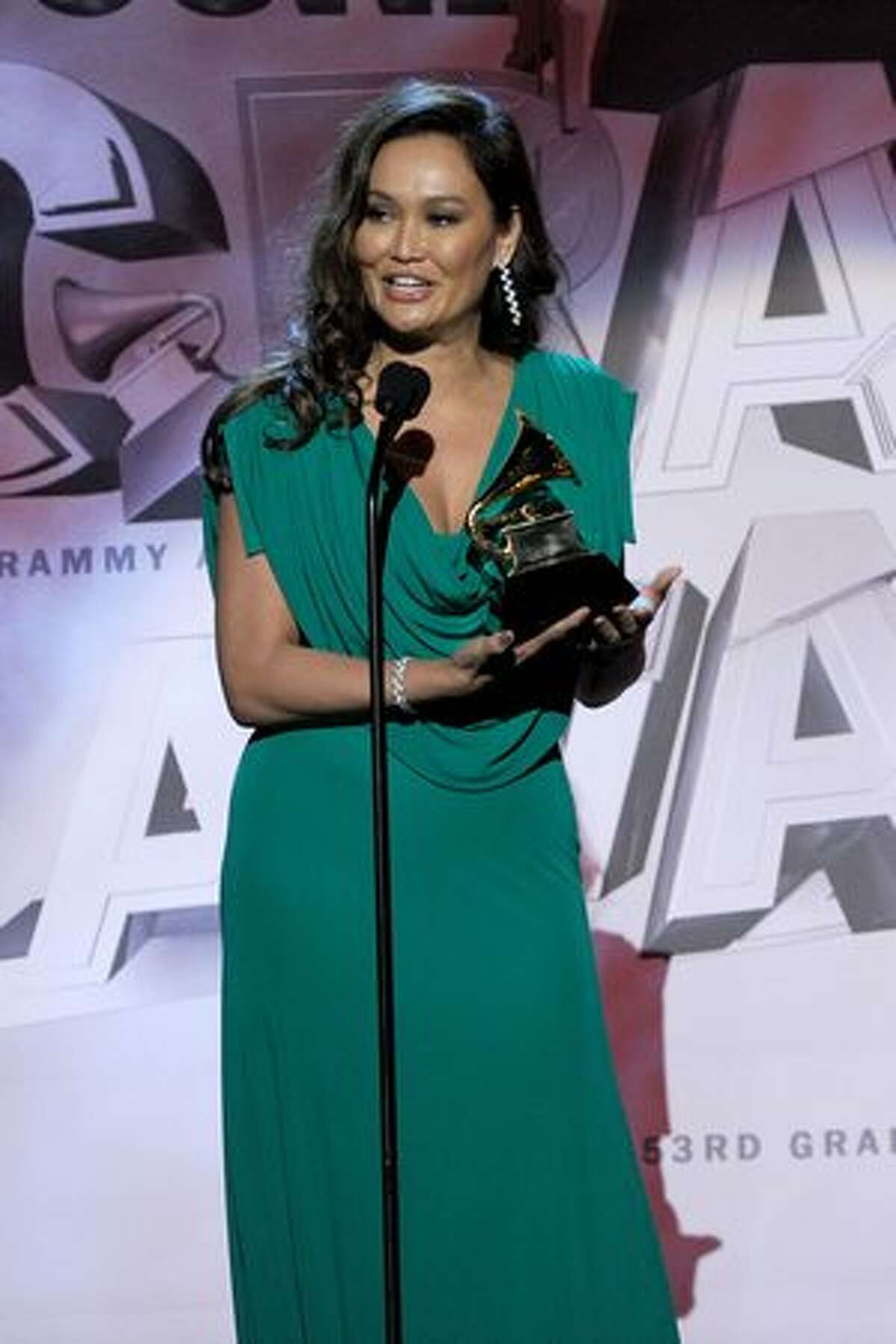 Singer Tia Carrere accepts the Best Hawaiian Music Album Award for Huana Ke Aloha onstage during The 53rd Annual GRAMMY Awards held at Staples Center in Los Angeles, California.