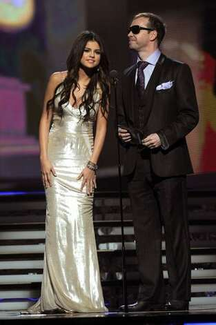 Singers Selena Gomez and Donnie Wahlberg speak onstage during The 53rd Annual GRAMMY Awards held at Staples Center in Los Angeles, California. Photo: Getty Images