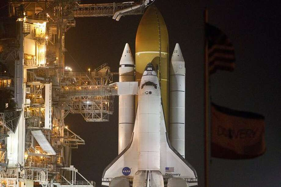 Space shuttle Discovery sits on launch pad 39A during the RSS (Rotating Service Structure) rollback in preparation of Discovery's final flight on the STS-133 International Space Station Mission. Photo: James Nielsen, Houston Chronicle