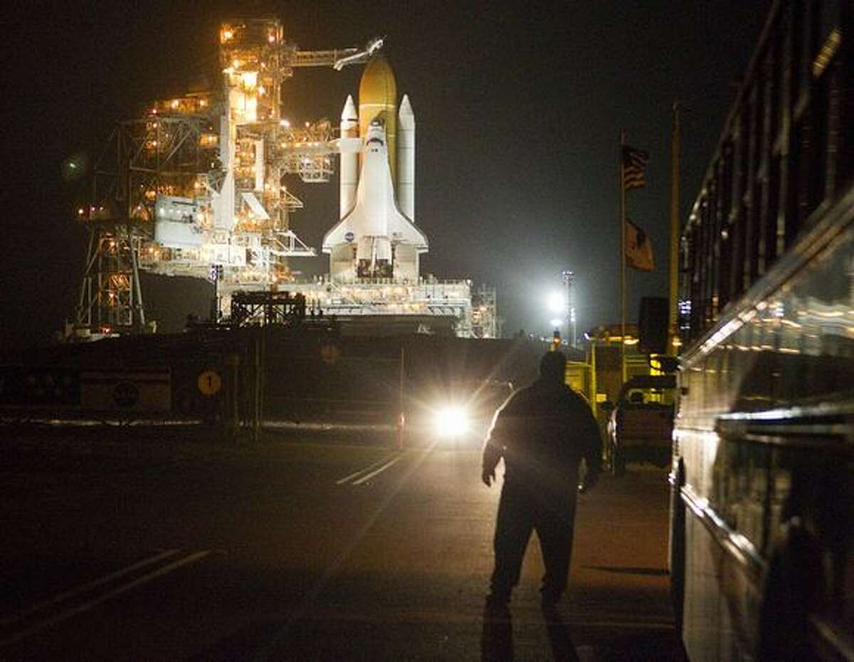Space shuttle Discovery sits on launch pad 39A during the RSS (Rotating Service Structure) rollback in preparation of Discovery's final flight on the STS-133 International Space Station Mission.