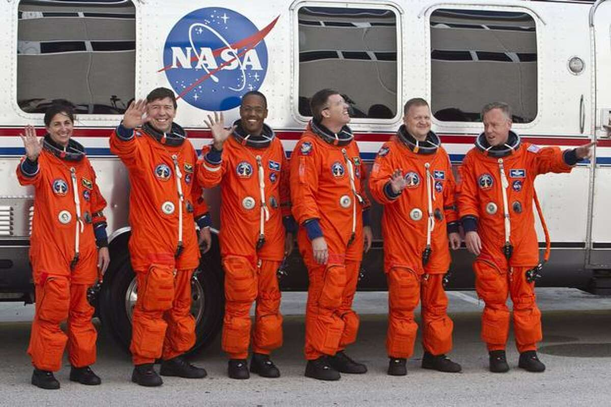 Space shuttle Discovery's STS-133 astronauts left to right, Nicole Scott, Michael Barratt, Alvin Drew, Steven Bowen, pilot Eric Boe and commander Steven Lindsey during the crew walkout for the space shuttle Discovery's final mission at NASA Kennedy Space Center.