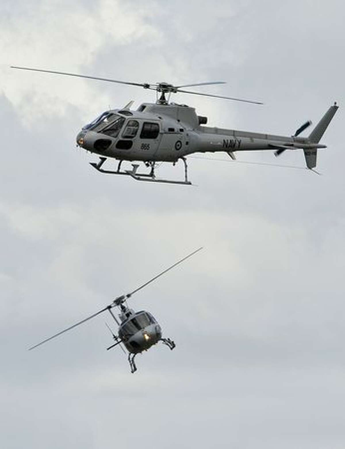 Royal Australian Navy squirrel helicopters perform on the opening day of the Australian International Airshow and Aerospace and Defence Expo in Melbourne.