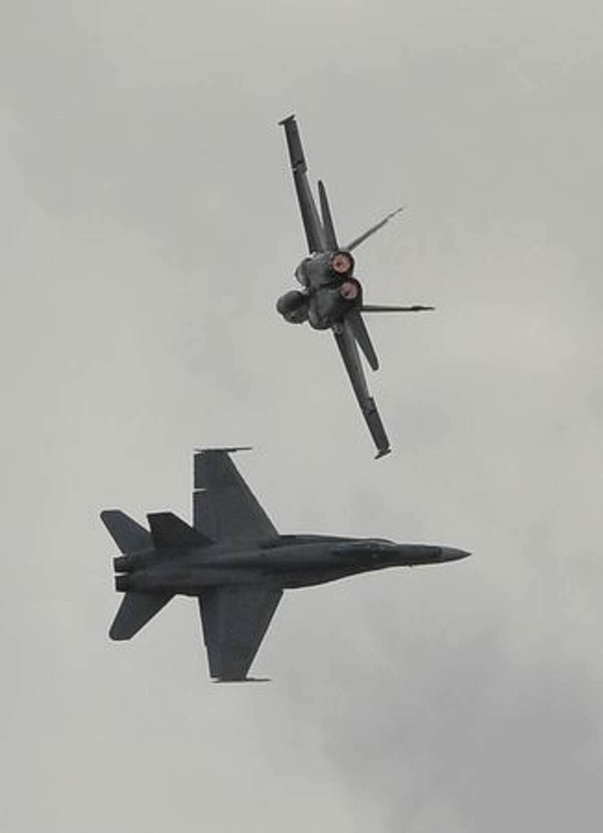 Royal Australian Air Force F-18s perform on the opening day of the Australian International Airshow and Aerospace and Defence Expo in Melbourne.
